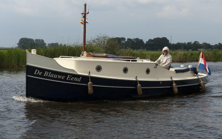 Giethoorn No limit Ships Blauwe Stad dag  E.J.Bruinekool Fotografie Hilversum  Copyright naamsvermelding verplicht lid NVJ. Berlagelaan 62, 1222JZ,  Hilversum, Nederland, tel. 31(0)356850950, fax. 31 356479199
